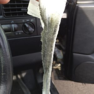 Baby wipe with grease and crap on it from the steering wheel contacts